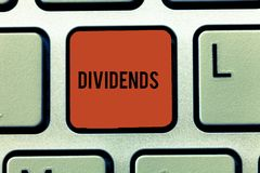 Word writing text Dividends. Business concept for sum of money paid regularly by company to shareholders out profits. Keyboard key Intention to create computer royalty free stock images