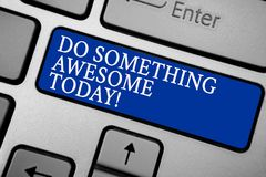 Word writing text Do Something Awesome Today. Business concept for Make an incredible action motivate yourself Grey silvery keyboa. Rd with bold blue color Stock Photos