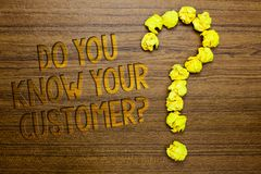Word writing text Do You Know Your Customer question. Business concept for Have into account client likes opinion Wooden floor wit. H some letters yellow paper stock photos
