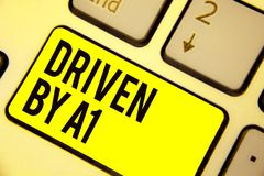 Word writing text Driven By A1. Business concept for Move or controlled by a top quality driver in the society Keyboard yellow key stock image