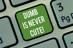 Word writing text Dumb Is Never Cute. Business concept for To be stupid ignorant is never an attractive feature Keyboard. Key Intention to create computer royalty free illustration