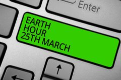 Word writing text Earth Hour 25Th March. Business concept for symbol commitment to planet Organized World Wide Fund Keyboard green. Button hit key typing work Stock Photo