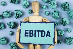 Word writing text Ebitda. Business concept for Earnings before tax is measured to evaluate company performance written on Sticky n. Word writing text Ebitda Royalty Free Stock Images
