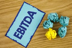 Word writing text Ebitda. Business concept for Earnings before tax is measured to evaluate company performance written on Sticky N. Word writing text Ebitda Stock Photo