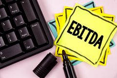 Word writing text Ebitda. Business concept for Earnings before tax is measured to evaluate company performance written on Sticky N. Word writing text Ebitda Royalty Free Stock Photo