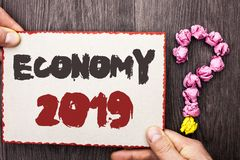 Word writing text Economy 2019. Business concept for Financial Currency Growth Market Earnings Trade Money written on Cardboard Pi. Word writing text Economy Stock Images