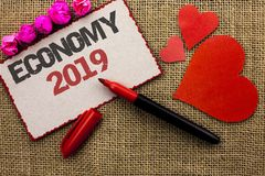 Word writing text Economy 2019. Business concept for Financial Currency Growth Market Earnings Trade Money written on Cardboard Pi. Word writing text Economy Stock Photos