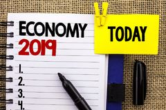 Word writing text Economy 2019. Business concept for Financial Currency Growth Market Earnings Trade Money written on Notebook boo. Word writing text Economy Royalty Free Stock Images