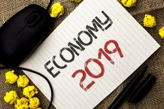 Word writing text Economy 2019. Business concept for Financial Currency Growth Market Earnings Trade Money written on Notebook Pap. Word writing text Economy Royalty Free Stock Image