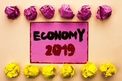 Word writing text Economy 2019. Business concept for Financial Currency Growth Market Earnings Trade Money written on Pink Sticky. Word writing text Economy 2019 Royalty Free Stock Images