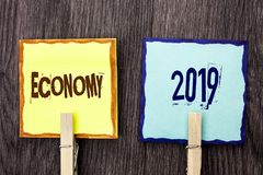 Word writing text Economy 2019. Business concept for Financial Currency Growth Market Earnings Trade Money written on Sticky Note. Word writing text Economy 2019 Stock Images