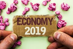 Word writing text Economy 2019. Business concept for Financial Currency Growth Market Earnings Trade Money written on Tear Cardboa. Word writing text Economy Royalty Free Stock Photography