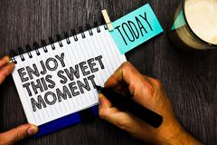 Word writing text Enjoy This Sweet Moment. Business concept for encouraging someone to love his life timeline Man holding marker n. Otebook clothespin hold stock photo