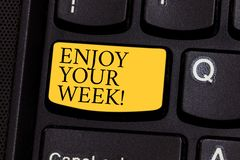 Word writing text Enjoy Your Week. Business concept for Best wishes for the start of weekdays have great days Keyboard. Key Intention to create computer message royalty free stock photography