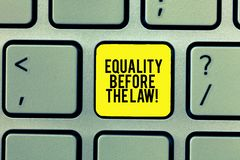 Word writing text Equality Before The Law. Business concept for Justice balance protection equal rights for everyone. Keyboard key Intention to create computer stock photos