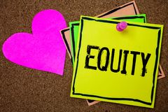 Word writing text Equity. Business concept for Value of a company divided into equal parts owned by shareholders Cork background p. Aper ideas messages pink stock photography