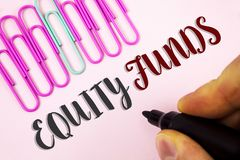 Word writing text Equity Funds. Business concept for Investors enjoys great benefits with long term investment written by Man hold. Ing Marker Plain Pink Royalty Free Stock Photography