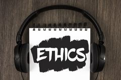 Word writing text Ethics. Business concept for Maintaining equality balance among others having moral principles written on Notepa. Word writing text Ethics Royalty Free Stock Photo