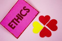 Word writing text Ethics. Business concept for Maintaining equality balance among others having moral principles written on Sticky. Word writing text Ethics Stock Image