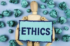 Word writing text Ethics. Business concept for Maintaining equality balance among others having moral principles written on Sticky. Word writing text Ethics Royalty Free Stock Photography