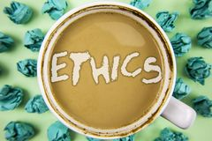 Word writing text Ethics. Business concept for Maintaining equality balance among others having moral principles written on Tea in. Word writing text Ethics Royalty Free Stock Photos