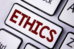 Word writing text Ethics. Business concept for Maintaining equality balance among others having moral principles written on White. Word writing text Ethics Royalty Free Stock Image