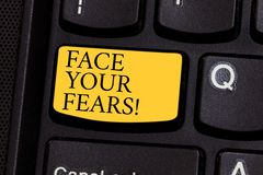 Word writing text Face Your Fears. Business concept for Have the courage to overcome anxiety be brave fearless Keyboard. Key Intention to create computer stock images
