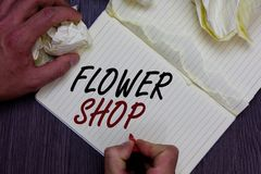 Word writing text Flower Shop. Business concept for where cut flowers are sold with decorations for gifts Man holding marker noteb stock photography