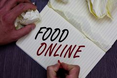 Word writing text Food Online. Business concept for asking for something to eat using phone app or website Man holding marker note. Book crumpled papers ripped Stock Image