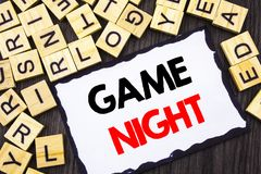 Word, writing, text  Game Night. Business concept for Entertainment Fun Play Time Event For Gaming written on Skicky Note Paper on Stock Photo