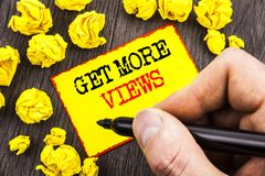 Word, writing, text  Get More Views. Business concept for More Traffic Leads Online Page Promotion Popularity Traffic written By M. An Holding Marker Sticky Note Royalty Free Stock Photos