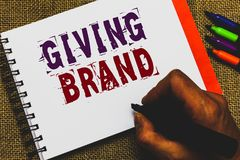 Word writing text Giving Brand. Business concept for The process of giving a Name to a company products or services Man hand holdi stock images