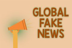 Word writing text Global Fake News. Business concept for False information Journalism Lies Disinformation Hoax Hand brown loud spe. Aker sound public message hot Stock Photos