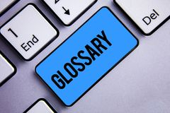 Word writing text Glossary. Business concept for Alphabetical list of terms with meanings Vocabulary Descriptions Keyboard blue ke royalty free stock photo