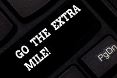 Word writing text Go The Extra Mile. Business concept for Give an additional do more than is expected from you Keyboard. Key Intention to create computer royalty free stock photo