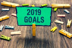 Word writing text 2019 Goals. Business concept for A plan to do for something new and better for the coming year Clothespin holdin. G green paper note several royalty free stock photos