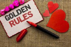 Word writing text Golden Rules. Business concept for Regulation Principles Core Purpose Plan Norm Policy Statement written on Card. Word writing text Golden Royalty Free Stock Images