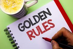 Word writing text Golden Rules. Business concept for Regulation Principles Core Purpose Plan Norm Policy Statement written by Man. Notebook Book Holding Marker Royalty Free Stock Image