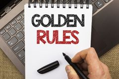 Word writing text Golden Rules. Business concept for Regulation Principles Core Purpose Plan Norm Policy Statement written by Man. Holding Pen Notebook Book Stock Photos