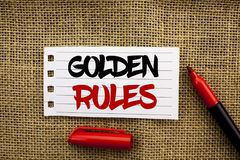 Word writing text Golden Rules. Business concept for Regulation Principles Core Purpose Plan Norm Policy Statement written on Note. Word writing text Golden stock images
