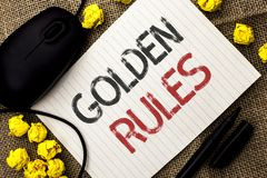 Word writing text Golden Rules. Business concept for Regulation Principles Core Purpose Plan Norm Policy Statement written on Note. Word writing text Golden Royalty Free Stock Image