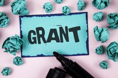 Word writing text Grant. Business concept for Money given by an organization or government for a purpose Scholarship written on St. Word writing text Grant Royalty Free Stock Photo