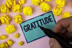 Word writing text Gratitude. Business concept for Quality of being thankful Appreciation Thankfulness Acknowledge written by Man o. Word writing text Gratitude Stock Photo
