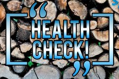 Word writing text Health Check. Business concept for Medical Examination Diagnosis Tests to prevent diseases Wooden background. Vintage wood wild message ideas stock photography