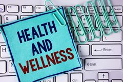 Word writing text Health And Wellness. Business concept for being in good shape Healthy food workout drink water written on Sticky. Word writing text Health And Royalty Free Stock Image