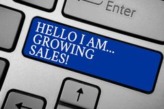 Word writing text Hello I Am... Growing Sales. Business concept for Making more money Selling larger quantities Grey silvery keybo. Ard with bold blue color royalty free stock images