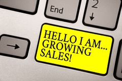 Word writing text Hello I Am... Growing Sales. Business concept for Making more money Selling larger quantities Grey silvery keybo. Ard with bright yellow color stock photo
