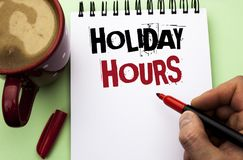 Word writing text Holiday Hours. Business concept for Celebration Time Seasonal Midnight Sales Extra-Time Opening written by Man. Notebook Book Holding Marker royalty free stock photos