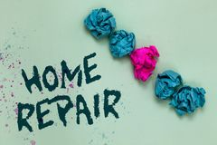 Word writing text Home Repair. Business concept for maintenance or improving your own house by yourself using tools Aligned crumpl. Ed wrinkled papers one stock photos