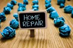 Word writing text Home Repair. Business concept for maintenance or improving your own house by yourself using tools Blackboard cru. Mpled papers several tries stock image